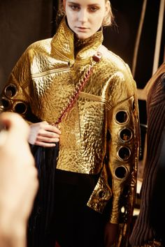 Metallic gold outerwear backstage at Just Cavalli AW14 MFW. Shot by Paolo Musa. More images here: http://www.dazeddigital.com/fashion/article/18962/1/just-cavalli-aw14