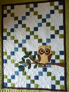 Holy cow, I LOVE this quilt!! The owl is so neat and the quilting is gorgeous!