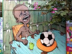 World Cup 2014: Brazil street artist Paulo Ito taps into country's anger with mural of starving child eating a football