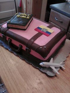 Commissioning Ceremony/Farewell - I made this cake for my daughter's comminsioning service as a missionary doctor to Ecuador. I made the three things that she was going to need the most: Her suitcase (clothes of course), her Bible and her doctor's bag.The suitcase is yellow cake done in buttercream with fondant straps and Ecuadorian flag. The Bible is RKT covered in fondant. The doctor's bag is pound cake covered in chocolate fondant. TFL