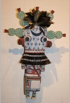 The Cactus or Yongotsina Katsina represents the spirit of the Opuntia or 'paddle cactus' Clark Tenakhongva, a member of the Rabbit Clan from the village of Hotvela on 3rd Mesa, is one of a small handfull of Hopi carvers who help helped revive the old style Katsina dolls, complete with traditional mineral paints (hematite, ochre, copper oxide, etc).