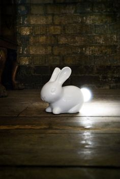 Porcelain white rabbit with a light-up tail
