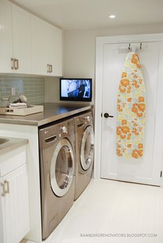 love the backsplash tiles, clean flooring and TV in the laundry room!