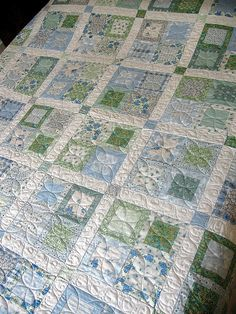 Quilting for 4 blocks within a block    Blue & Green Quilt by QOB, via Flickr Very nice...