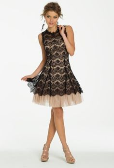 Timeless elegance meets sassy style in this beautiful short dress that's just too good to resist! It's a very aesthetically pleasing style that can work for several occasions, including Homecoming. You'll love the A-line skirt with head to toe two-toned hues and lace overlay. Make a major style statement on the dance floor in this beauty! You can even wear this as a Guest of Wedding dress. Complement your look with a pair of textured zipper back sandal, shimmery sparkle clutch bag and matte…