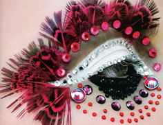 Showy fantasy eye make-up with crystals and feathers galore!