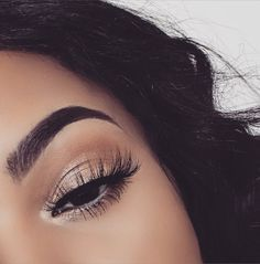Thick brows and voluminous curled lashes