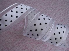 This listing is for 5 Yards of ribbon  Color: White with Black Polka Dots  Approximately 1 1/2 wide.  Wired edge.  Price is for 5 yards. ( Sells in lots of 5 yards. If you need 10 yards, order 2 under quantity, etc ).  Orders for multiple yards of one item will be cut in one continuous cut whenever possible. If you do not see the quantity you need listed, please contact us and we will be happy to check inventory for you.  PLEASE NOTE: We do our very best to present our products accurately…