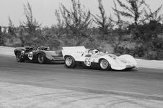 Hap Sharp leads Bob Bondurant in the 1965 Nassau Trophy race. Bondurant would lead briefly, but slide into a guard rail, damaging his Lola. Sharp would go on to win. Albert R. Bochroch photo.