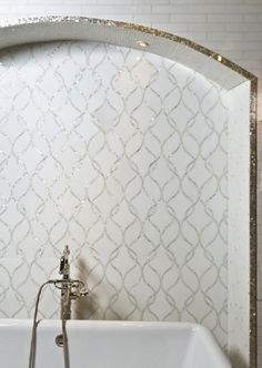The Claridges Tile from Artistic Tile gets its inspiration from the Claridges Hotel in London. The sinuous lines reflect an Art Nouveau past, yet still fell completely contemporary for today's interior. Available in several standard materials, my favorite is white marble with mother of pearl...