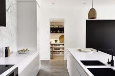 Black and white kitchen design. Designer: Mikayla Rose | Caesarstone: Blizzard