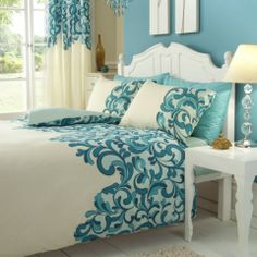 Swirl print bedding in teal and cream. http://www.worldstores.co.uk/p/Gaveno_Cavailia_Saville_Complete_Bedding_Set_in_Cream_and_Teal.htm