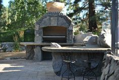Bolivian Charcoal BBQ!!!!!, 2 Charcoal BBQs built with large stone and small pebbles, and concrete countertops., 2 Charcoal ovens built with...
