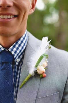 White feather boutonniere. #feathers #boutonniere #unexpected http://www.weddingchicks.com/2013/11/01/burlap-and-lace-wedding/
