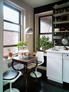 lots of on-wall shelving and small scale furniture for a dinner nook. nice.  Rent-Direct.com - Apartments for Rent in New York, with No Broker's Fee.