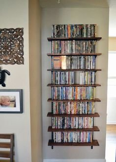 DVD storage can be difficult for small apartments and houses. Check out these 10 clever and easy DVD storage ideas for small spaces for a creativity push. Dvd Storage Cabinet, Dvd Storage Shelves, Diy Storage Boxes, Storage Ideas, Storage Solutions, Game Storage, Dvd Wall Shelf, Storage Units, Diy Media Storage