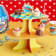A striking two-tier cupcake stand with the word