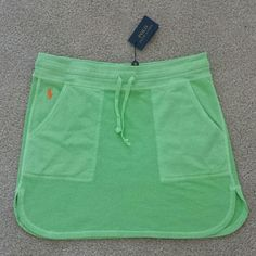 Polo RL dolphin hem mini skirt lime MOVING SALE!!! PRICED TO SELL. NO OFFERS PLEASE.  NWT Polo Ralph Lauren dolphin hem mini skirt with pockets in lime green with orange Polo logo Polo by Ralph Lauren Skirts Mini