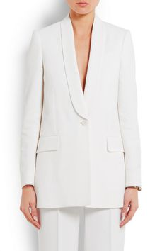 White crepe Lightly padded shoulders, buttoned cuffs, front flap pockets, double back vents, fully lined Button fastening at front 83% viscose, 17% wool; lining: 100% viscose Dry clean Made in ItalyAs seen in The EDIT magazine