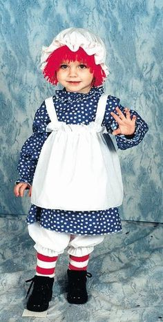 Description #12112/12114 She'll make the perfect Rag Doll this Halloween as Raggedy Ann. The Raggedy Ann Costume includes a white an blue dress with attached apron and striped stocking. The hat with a