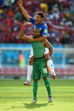 RECIFE, BRAZIL - JUNE 20: Goalkeeper Patrick Pemberton of Costa Rica celebrates with teammate Oscar Granados after defeating Italy 1-0 during the 2014 FIFA World Cup Brazil Group D match between Italy and Costa Rica at Arena Pernambuco on June 20, 2014 in Recife, Brazil. (Photo by Laurence Griffiths/Getty Images)