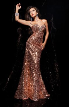 Tony Bowls Paris 113702 is a stunning mermaid dress with head to toe glittery gold sequins. This body-hugging gown is adorned in multi-colored crystals along the neckline highlighting the sweetheart neckline. Strut your stuff at prom, homecoming, or in pageants in this one of a kind dress!