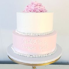 This lovely Christening cake is topped with sugar flower Hydrangeas with delicious Vanilla Buttercream Icing in white and pink #customcake