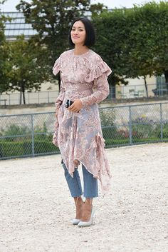 Street Style: formal dress over denim.