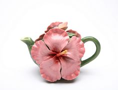 Hibiscus Teapot... I have a teapot but, if I saw this in a store, I'm pretty sure I would HAVE to have it. :)