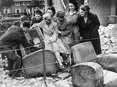 They salvaged a wireless set from their ruined home. September 1940.