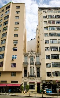A lone building remains, sandwiched between two ugly newcomers. Lapa, Rio de Janeiro.