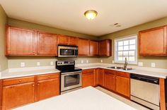 The kitchen is very open with stainless steel appliances and lots of counter space! Give us a call today 910.939.2262 for more information or click the link in our bio!