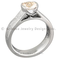Mokume Cathedral Ring with a Champagne Diamond - A cathedral bezel setting holds up the center stone in this Mokume Cathedral Solitaire Engagement Ring. The mokume band gently arches up to support an elegantly shaped setting that rests delicately upon a point.    - This designer ring has been customized with a round champagne diamond in a semi-bezel. Its band features White mokume.