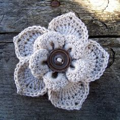 I love, love, love this flower. No pattern listed, but here is a link to one similar: http://www.bhookedcrochet.com/2014/01/18/lovely-layers-flower-free-pattern/
