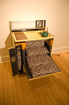Top Ingenious Recycled Furniture Design Ideas. The top comes off this former oven and becomes a lounge chair.