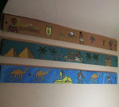 Egyption art on wood at bathroom wall Bathroom Wall, Wood Art, Flag, Artwork, River, Wooden Art, Work Of Art, Auguste Rodin Artwork, Artworks