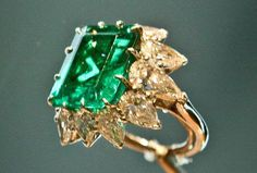 Elizabeth Taylor's Jewels~A ring in platinum with emerald and diamonds.