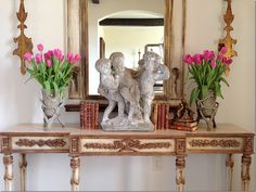 Providence Design's aesthetic is a mix of old and new.  The antique books add a warmth to the stone cherubs.