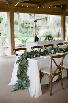 Rustic garland topped table: http://www.stylemepretty.com/2016/06/02/this-elegant-plantation-wedding-defines-southern-romance/ | Photography:Ashley Seawell Photography - http://ashleyseawellphotography.com/index2.php#!/HOME
