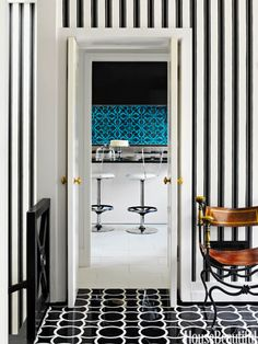 Graphic patterns extend from the foyer in a Washington, D.C. town house through to the kitchen. Design: Jeff Lincoln and Hillary Thomas.