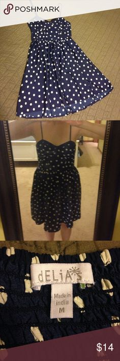 ⭐️Delia's dress Navy blue with cream polka dots! This dress is cute and sexy. Has adjustable spaghetti straps and a bustier-type bodice. The back is rusched to create a close fit. I have a 34A/B chest and the cups fit perfectly. I would say this is a juniors medium as I normally wear a size small dress. Excellent condition. Smoke free home! Dresses Mini