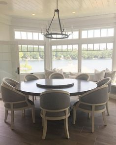 Kitchen nook. Kitchen nook with custom round table and chairs with a window seat under bay windows with transoms and tongue and groove ceiling. #Kitchennook Brooke Wagner Design