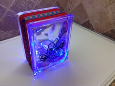 """SPECIAL ORDER """"SPIDER MAN"""" LASER ETCHED WITH RED RIBBON/SPIDERMAN  EMBELLISHMENT AND BLUE LED BATTERY OPERATED LIGHTS. Laser etching by Lavene & Co"""