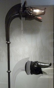 The carnyx was a wind instrument of the Iron Age Celts, used between c. 300 BC and c. AD 200. It was a type of bronze trumpet, held vertically, the bell styled in the shape of a boar's, or other animal's, head. It was used in warfare, probably to incite troops to battle and intimidate opponents.