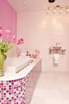 Without the visual, a pink- and purple-tiled bathroom sounds like ... well, not the best idea. But this thoughtfully designed space is a breath of fresh air. Colorful tiles interspersed with white ones and a single rosy pink accent wall infuse the setting with just enough hue to liven it up. Oh, and that pink sink? A knockout. - modern bathroom by Susan Jablon Mosaics