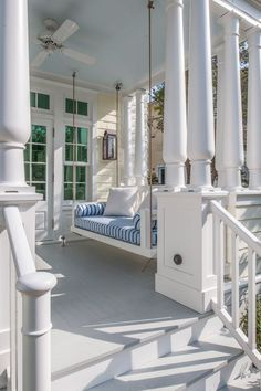 Beautiful porch. The swing is a perfect place to relax on a warm summer day. #homes #porches www.capecodrelo.com
