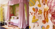 """""""Jonathan Adler covered a lampshade and canopy bed with vintage pink gingham for a girl's bedroom on New York's Upper East Side"""""""
