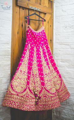 Bridal Lehengas - Fuchsia Pink Lehenga with Golden Embroidery and Border | WedMeGood #wedmegood #indianbride #lehenga #pink #bridal #indianwedding
