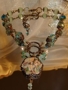 """Victorian Mermaid Bracelet by pameliadesigns on etsy. At first glance I thought it was a necklace but it is indeed a bracelet. """"The image bead print came from an antique victorian post card."""""""
