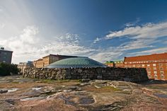Temppeliaukion church in Helsinki with copped dome and built on a rock.